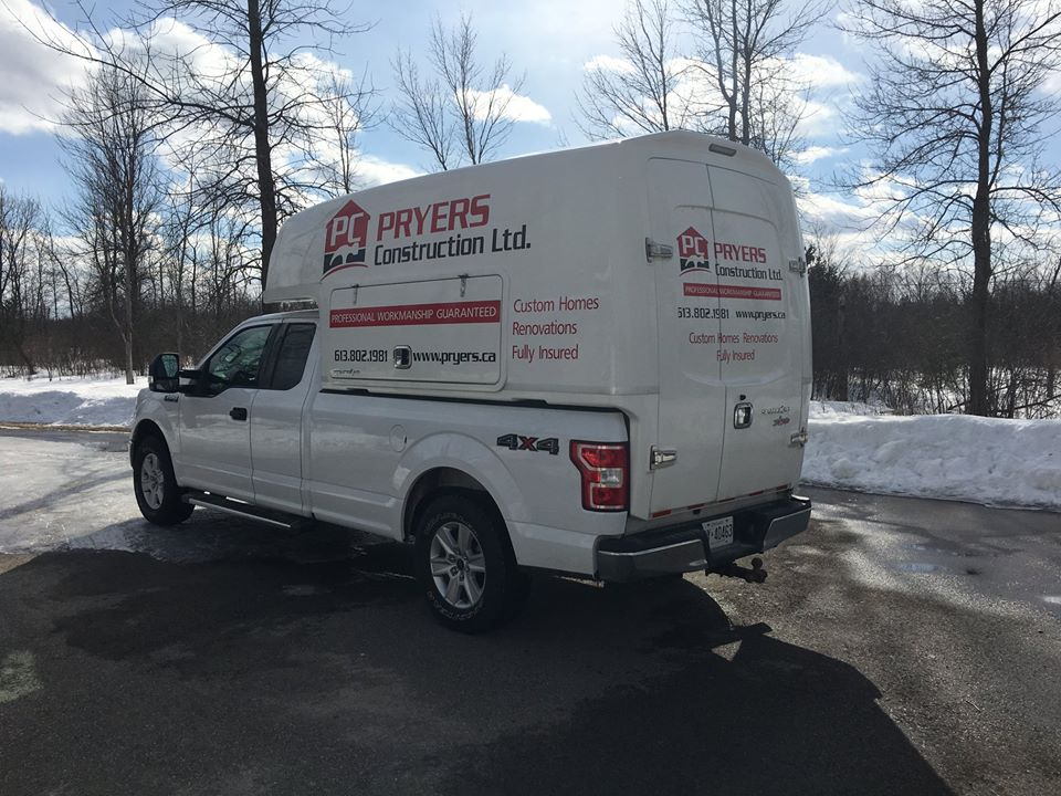white pickup truck with Pryers Construction logo