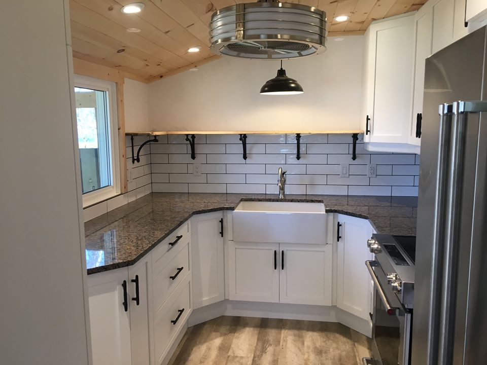 a kitchen sink with white cabinetry