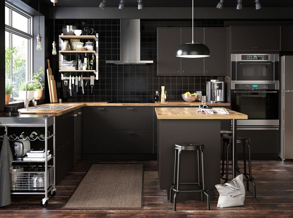 a kitchen with black cabinetry