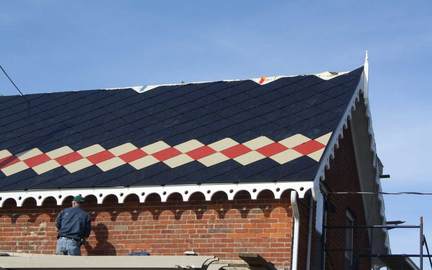 black tin roof with red and beige pattern